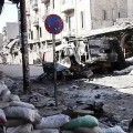 640px-Bombed_out_vehicles_Aleppo
